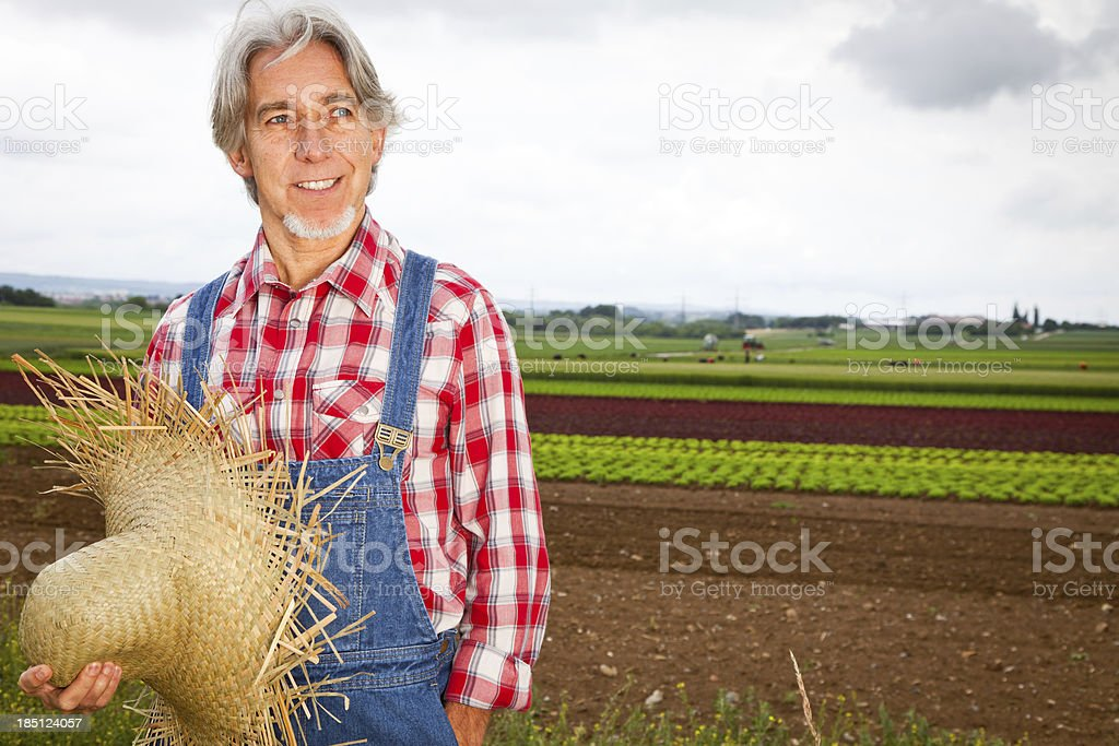 farmer standing in front of his field royalty-free stock photo