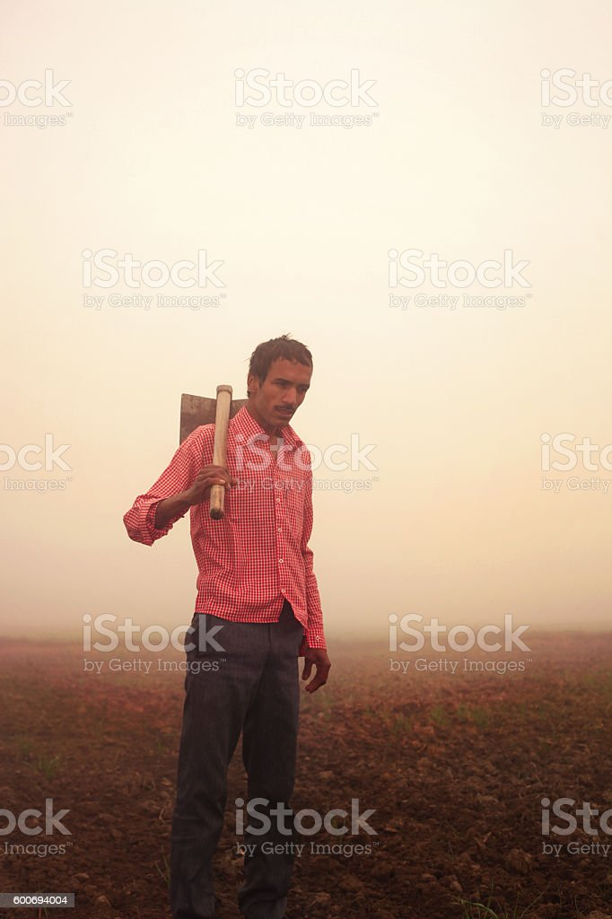 Farmer standing in the field stock photo