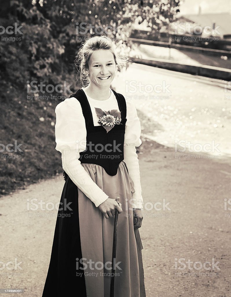 Farmer teenager girl in traditional Swiss costume stock photo