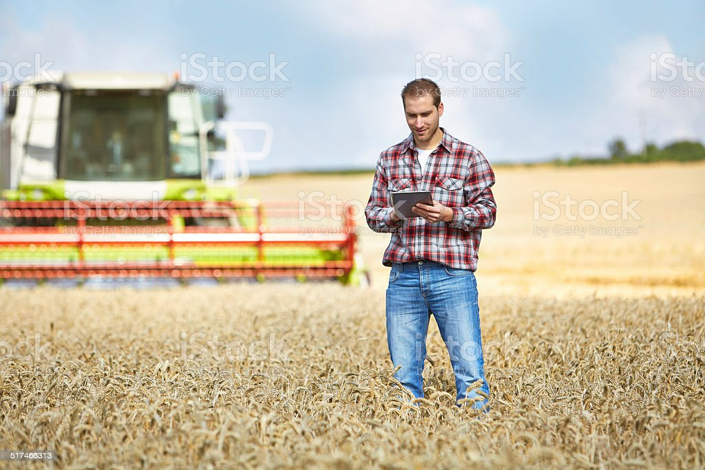 Farmer Types on tablet computer stock photo