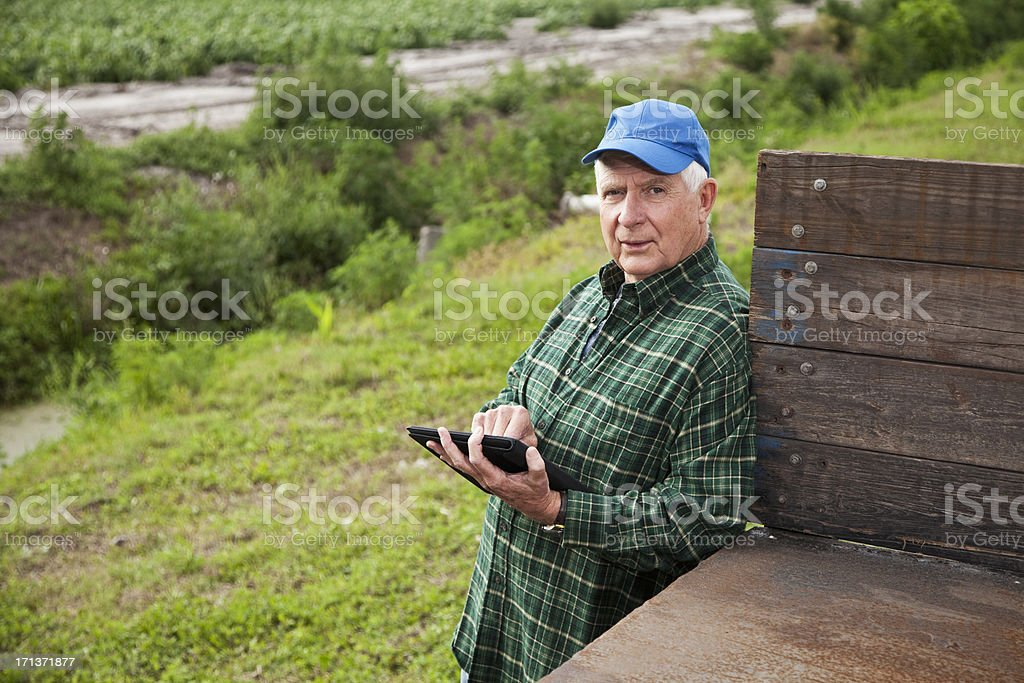 Farmer using digital tablet stock photo