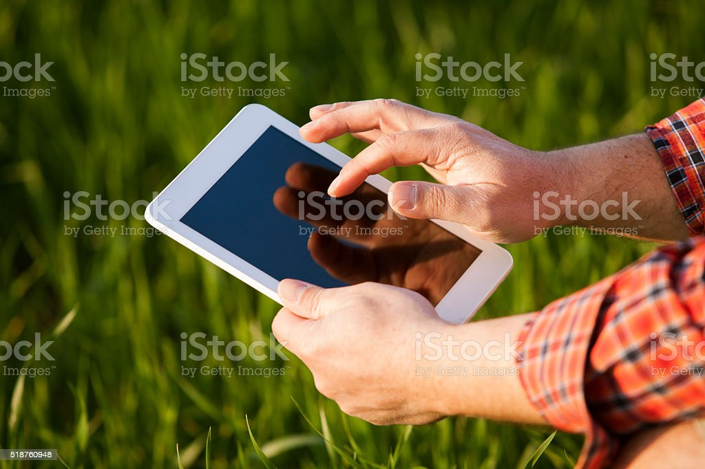 farmer using digital tablet stock photo