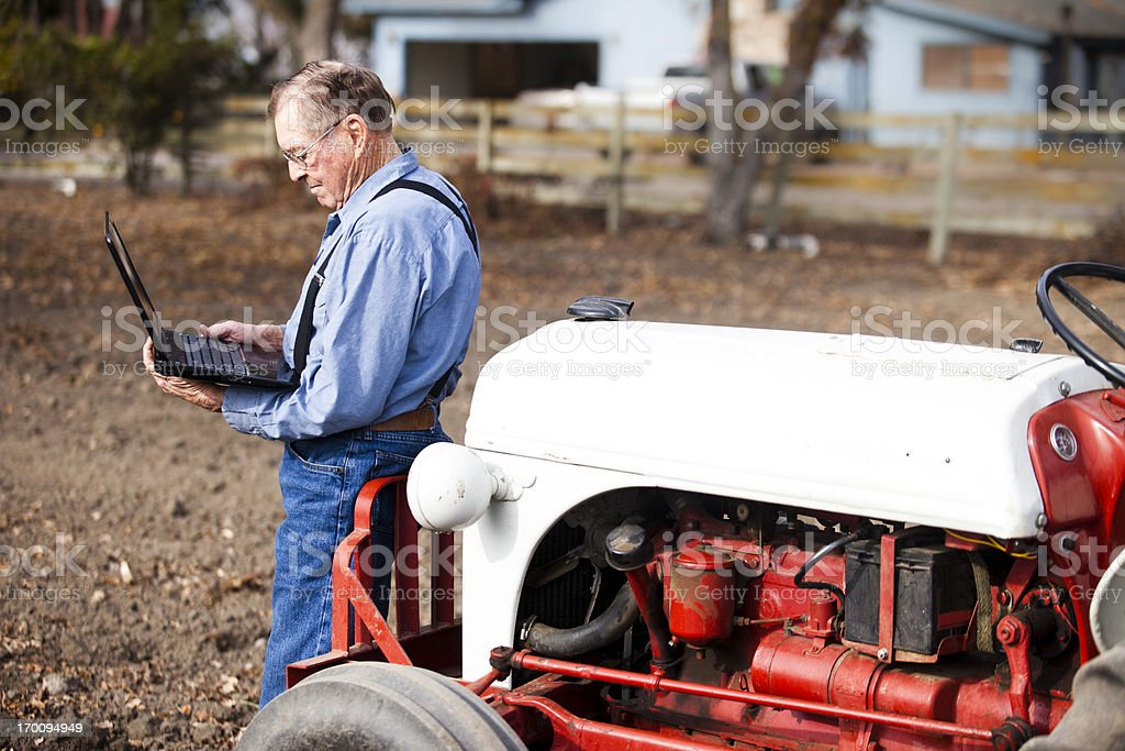 Farmer Using Laptop Computer stock photo