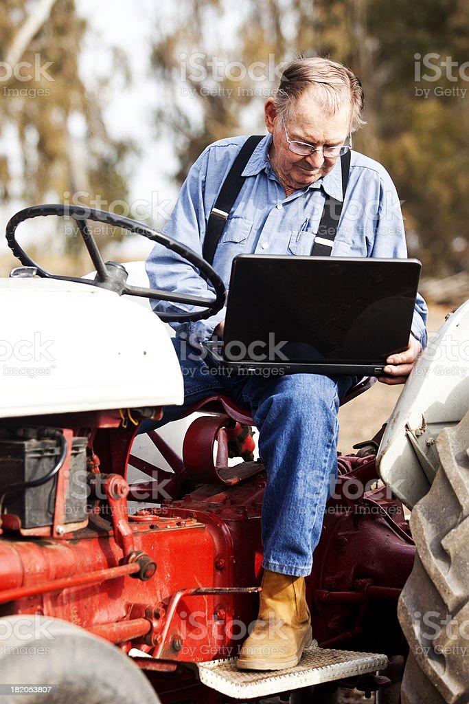 Farmer Using Laptop Computer royalty-free stock photo