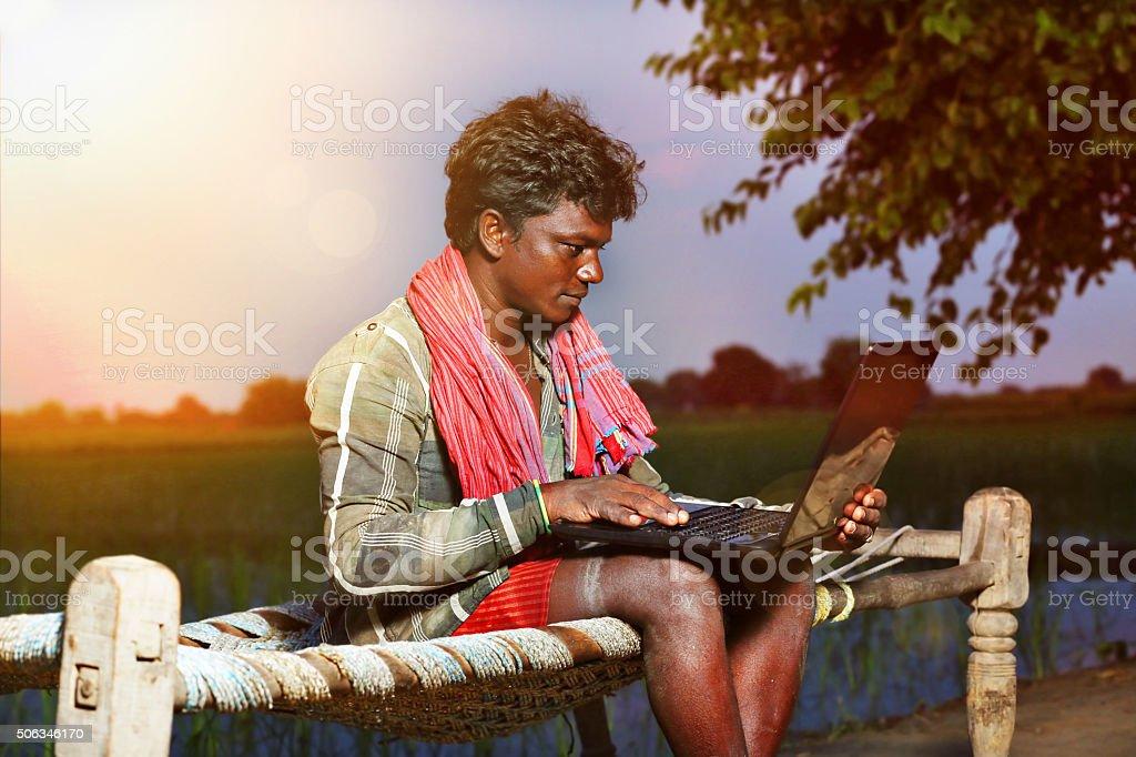Farmer Using Laptop stock photo
