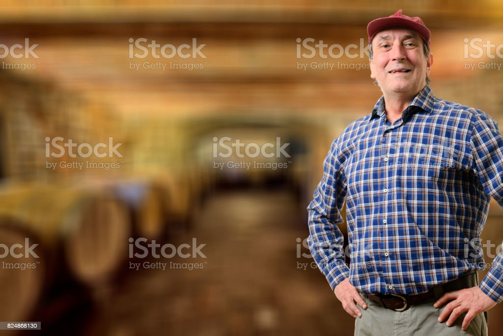 Farmer with barrels of wine stock photo