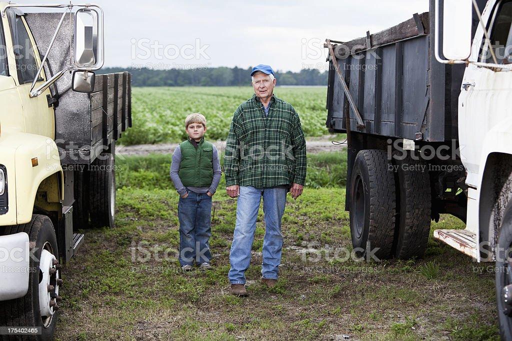 Farmer with grandson on potato farm stock photo