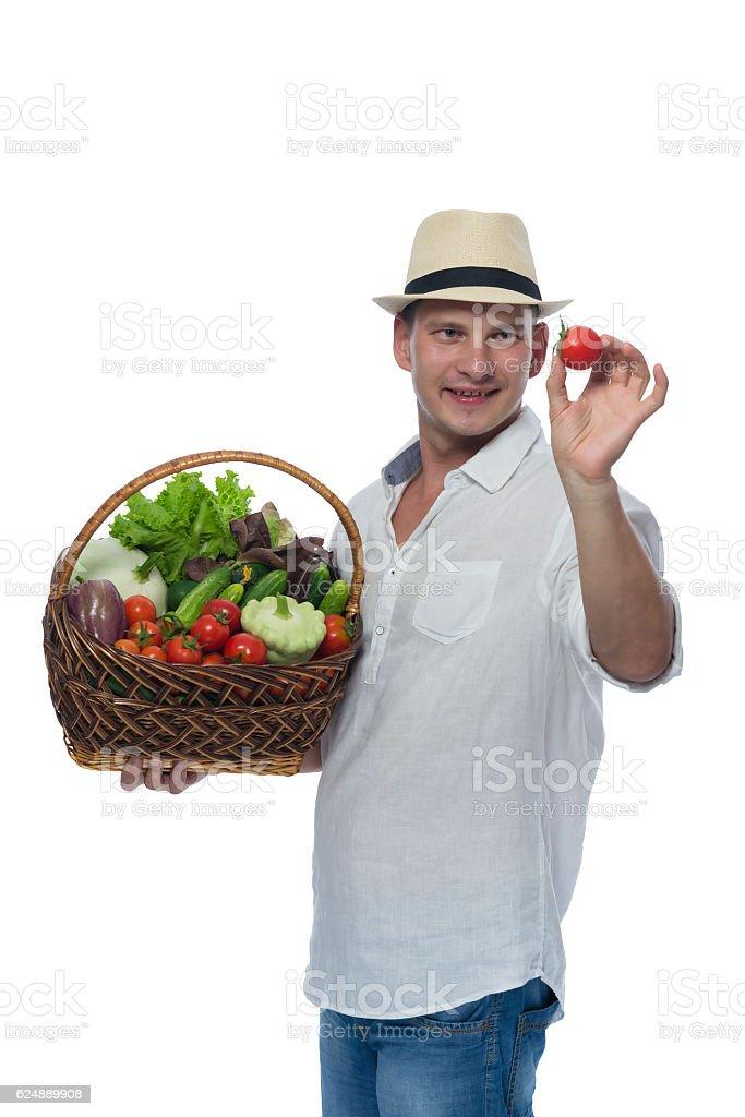 Farmer with harvest treats tomato in hand stock photo