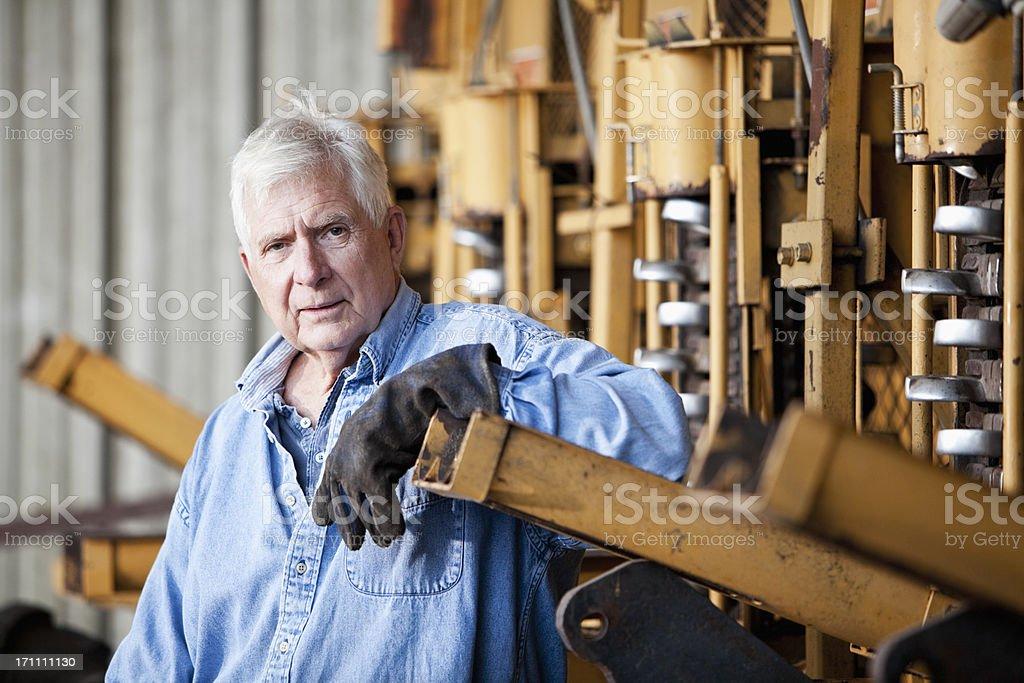 Farmer with harvester stock photo