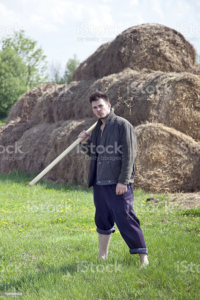 Farmer With Hay Fork royalty-free stock photo