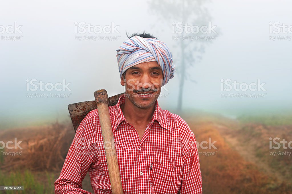 Farmer with Hoe stock photo