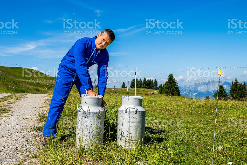 farmer with milk containers royalty-free stock photo