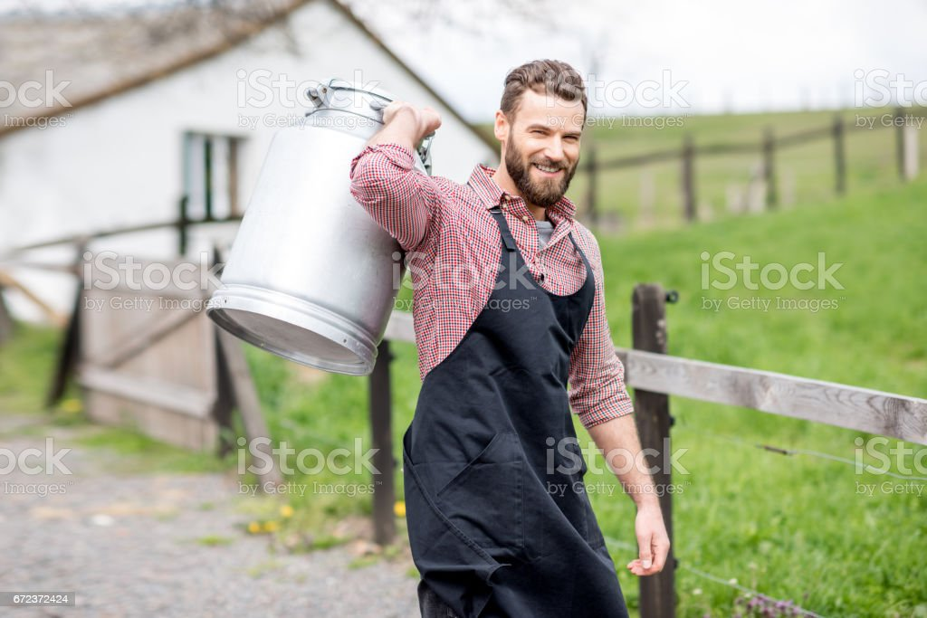 Farmer with milk outdoors stock photo