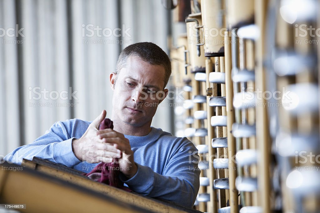Farmer with potato harvester wiping hands stock photo