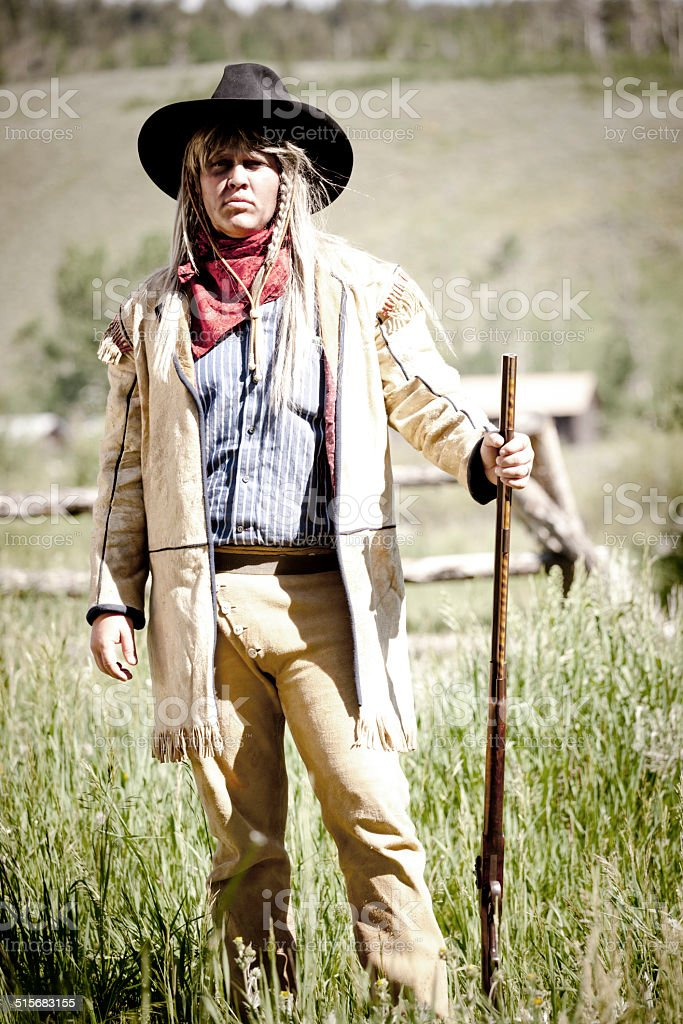 Farmer with rifle stock photo