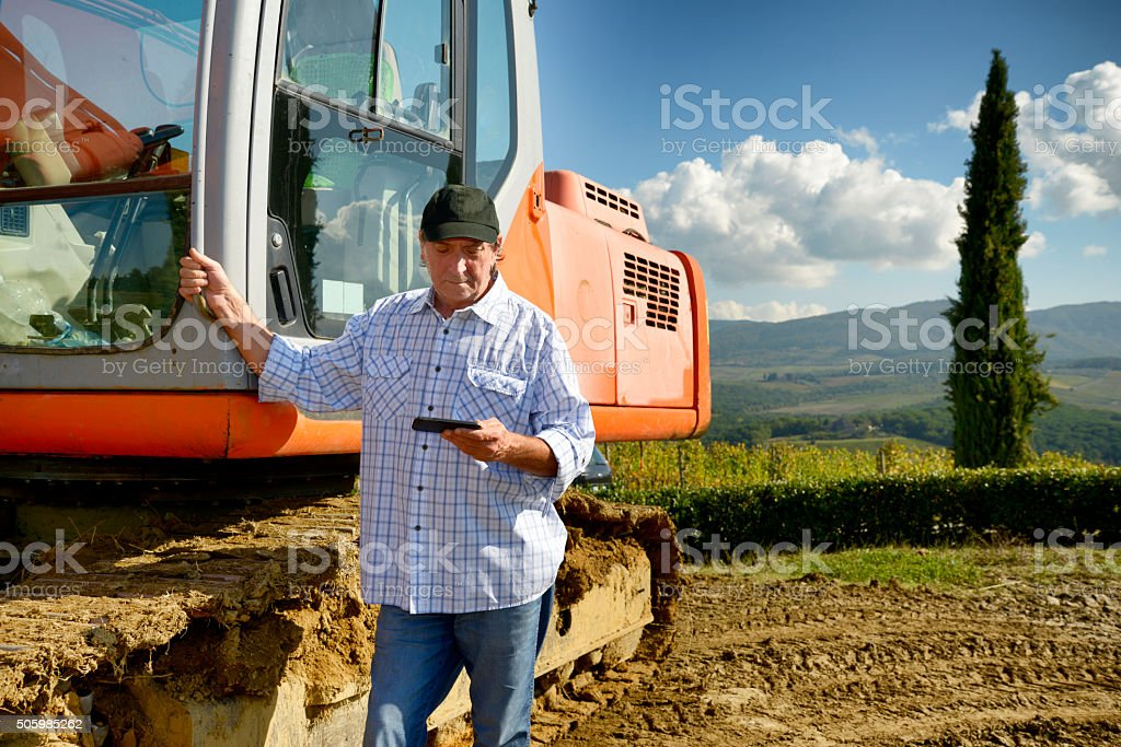 Farmer with tablet stock photo