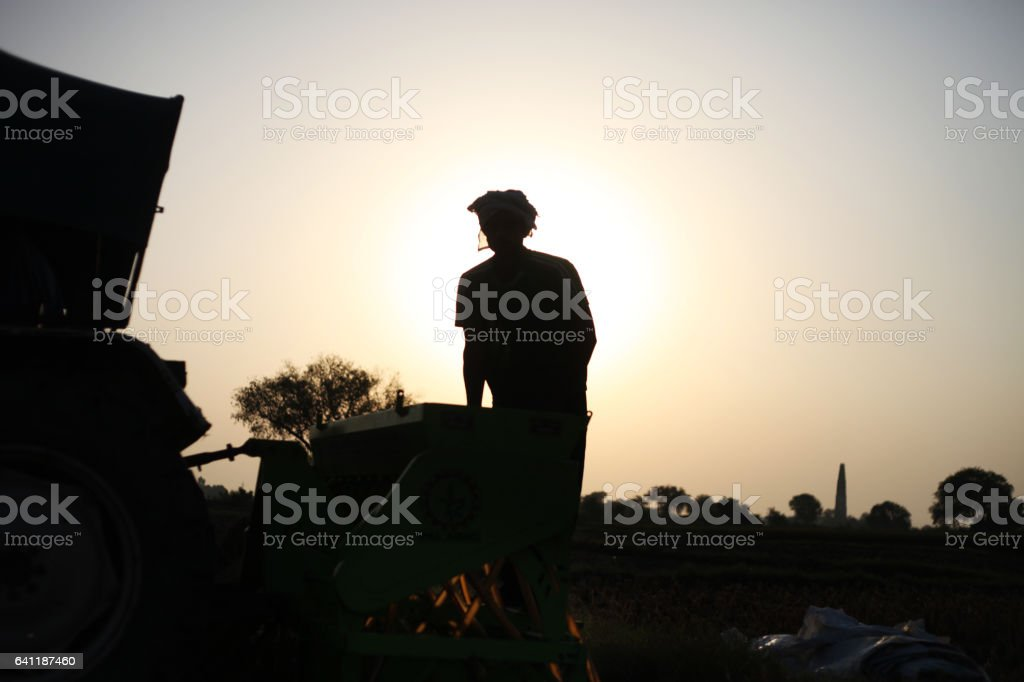 Farmer working in the field stock photo