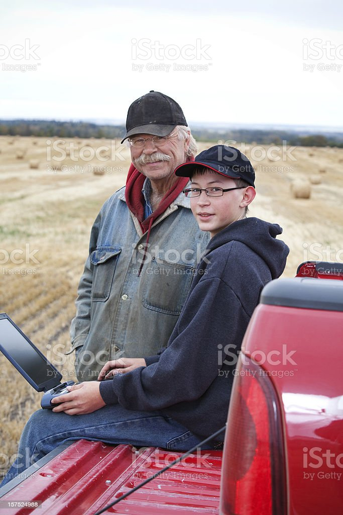 Farmers and Computer royalty-free stock photo