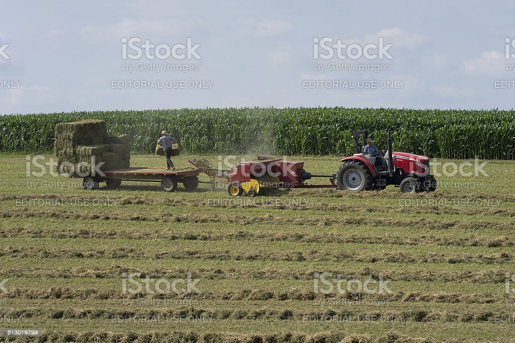 Farmers Baling Hay stock photo