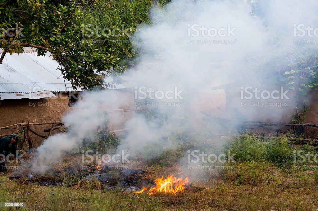 Farmers burn waste in fields causing pollution stock photo