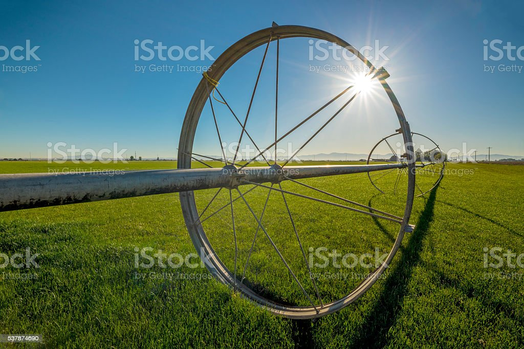 Farmers field and sprinkler pipe stock photo