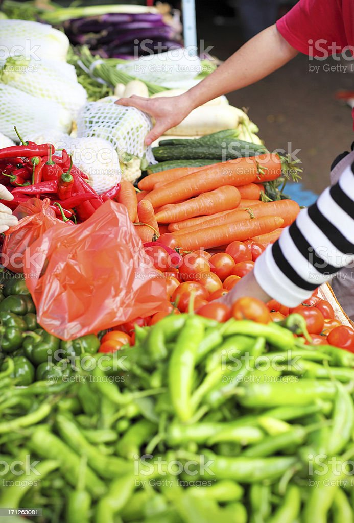 Farmer's Market: Setting out Fruits and Vegetables royalty-free stock photo