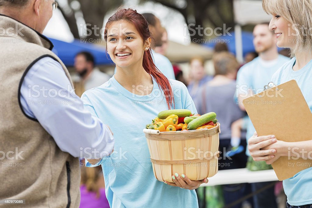 Farmers market worker helping customer stock photo