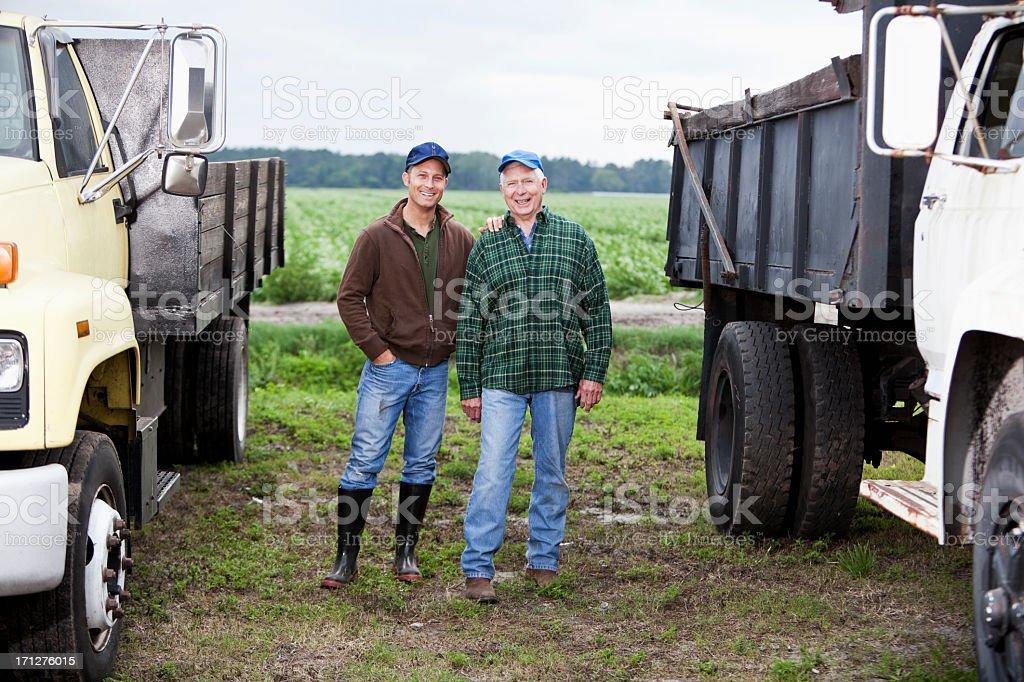 Farmers next to trucks stock photo
