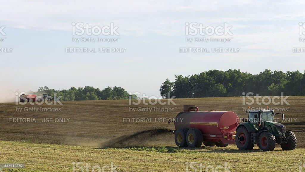 Farmers Spreading Liquid Manure stock photo