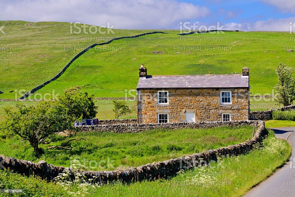 Farmhouse amid Hills and Meadows, Hadrian Wall area, United Kingdom. stock photo