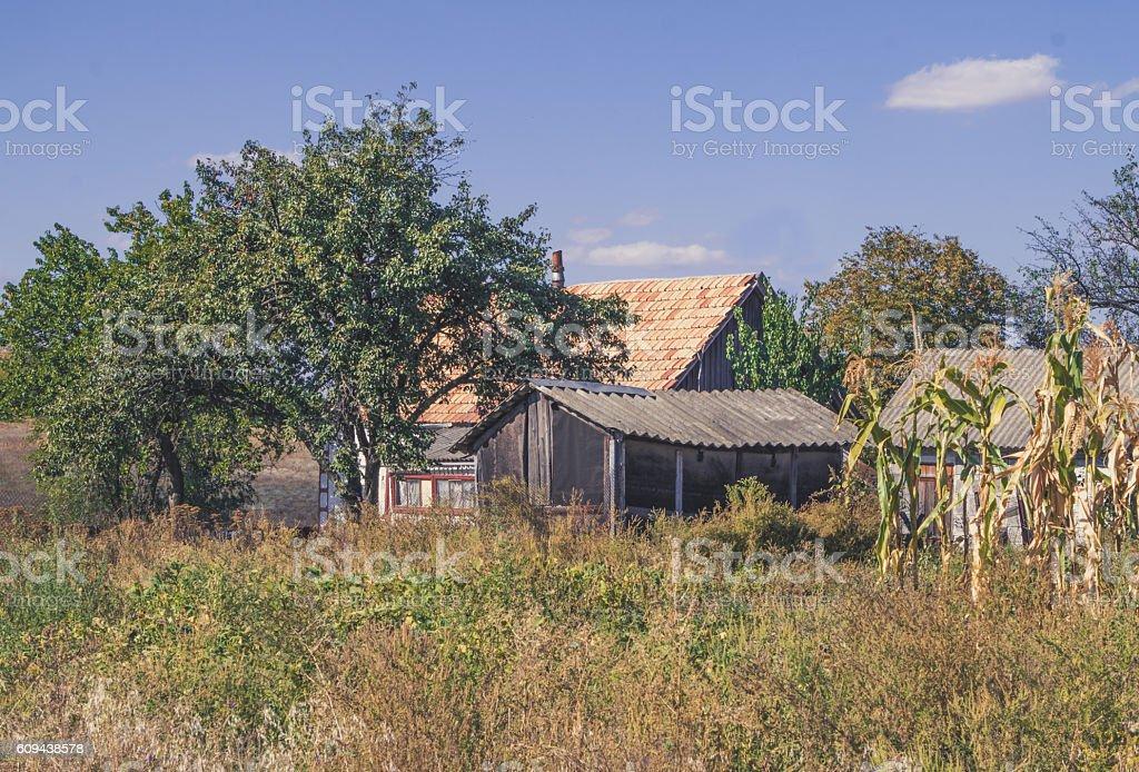 Farmhouse among autumn fields stock photo