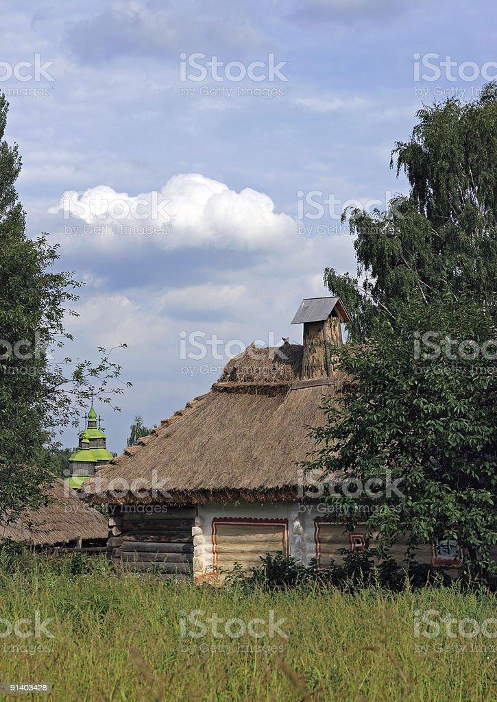 Farmhouse and field royalty-free stock photo