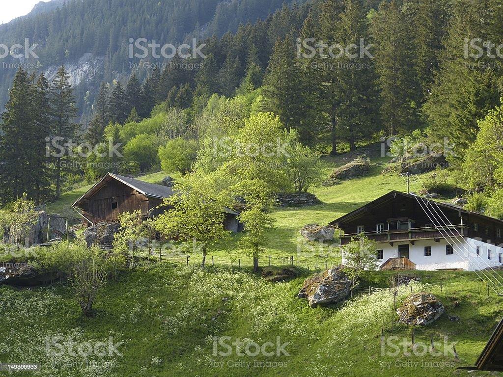 Farmhouse in the Austrian mountains royalty-free stock photo