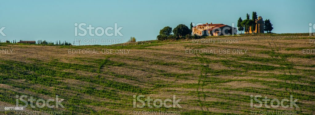 VAL D`ORCIA, TUSCANY-ITALY, OCTOBER 30, 2016: Farmhouse in the scenic Tuscany landscape with rolling hills and valleys in autumn, Val D'Orcia, Italy stock photo