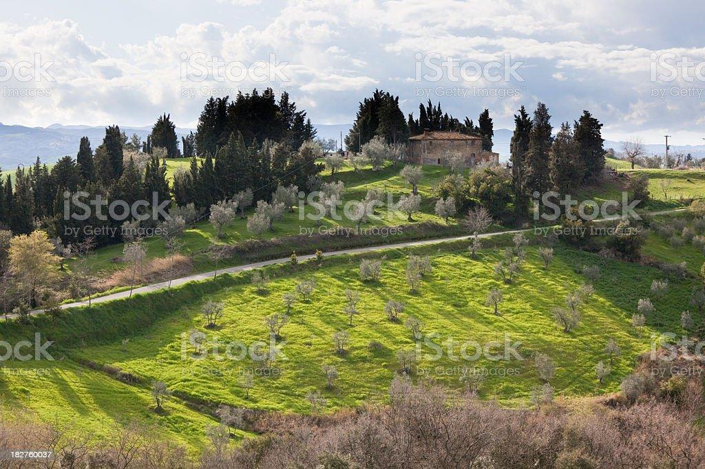 'Farmhouse on a hill near Volterra, Tuscany' stock photo