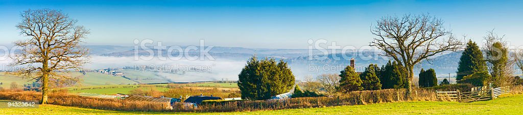 Farmhouse overlooking misty valley royalty-free stock photo