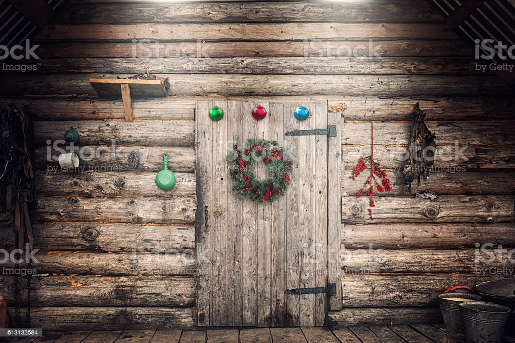 Farmhouse wall with Christmas decorations stock photo