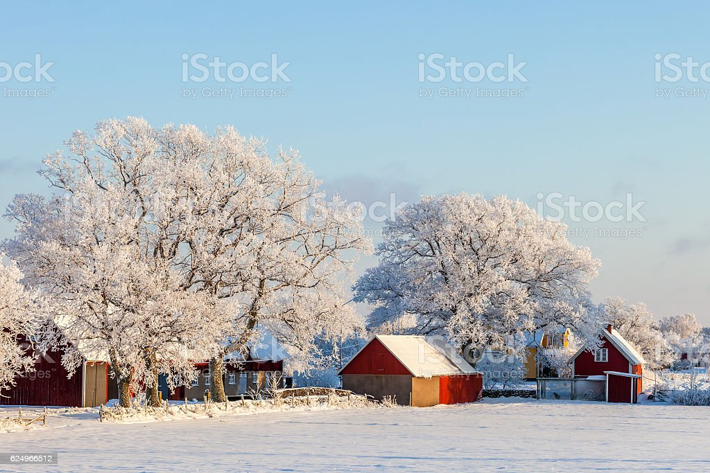 Farmhouse with frost and snow in the winter stock photo