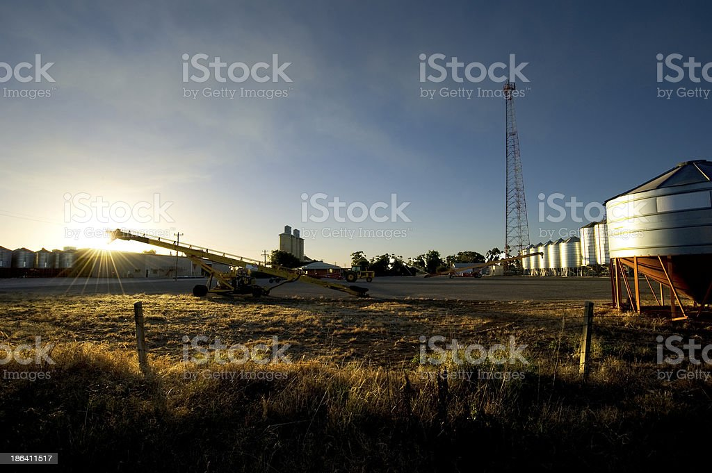 Farming equipment at first light stock photo