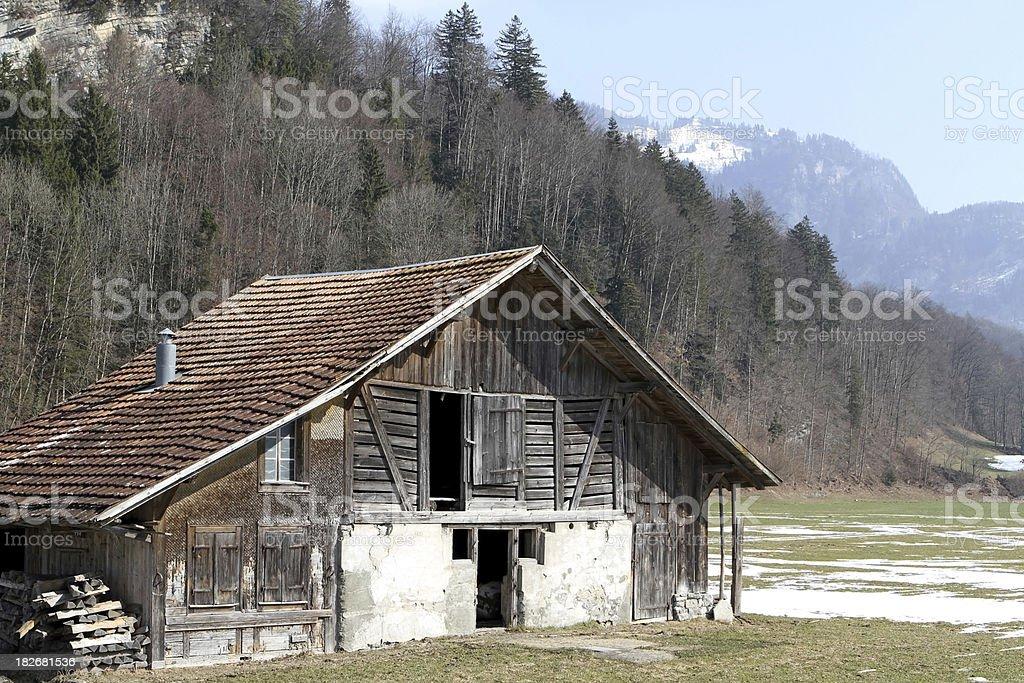 Farmland animal barn and woodstore.  Swiss Alps, Brienz, Berne, Switzerland royalty-free stock photo