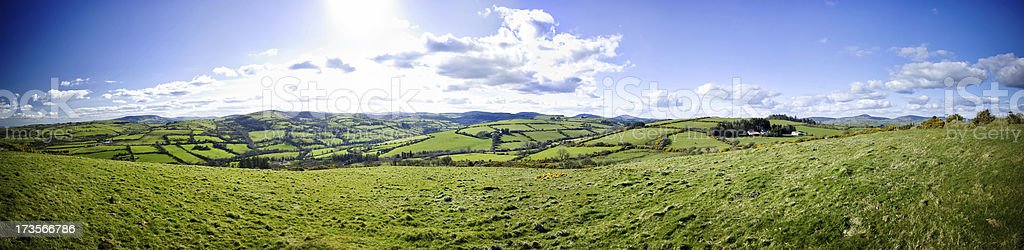 Farmland countryside panorama with rolling green hills in Tipperary, Ireland stock photo