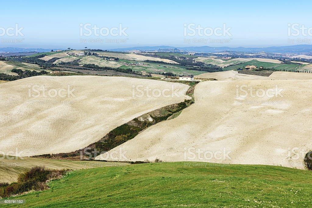Farmland near Asciano, Tuscany, Italy stock photo