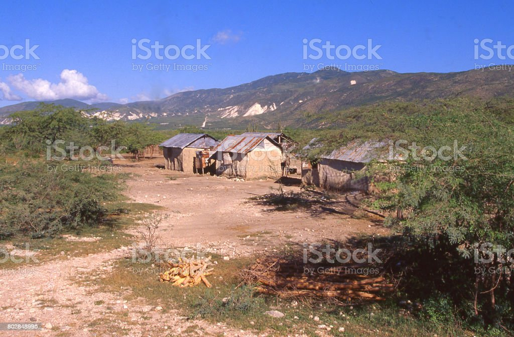 Farmsteads and eroded degraded land in thorn-bush land north of Port-au-Prince Haiti stock photo