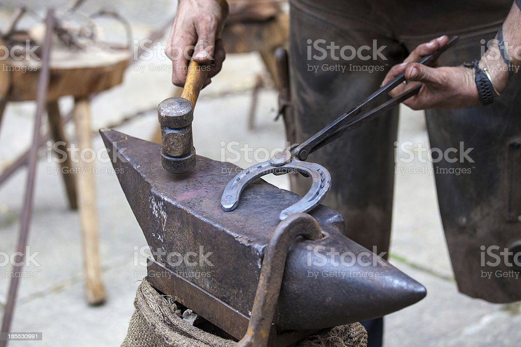 Farrier hits  horse shoe royalty-free stock photo
