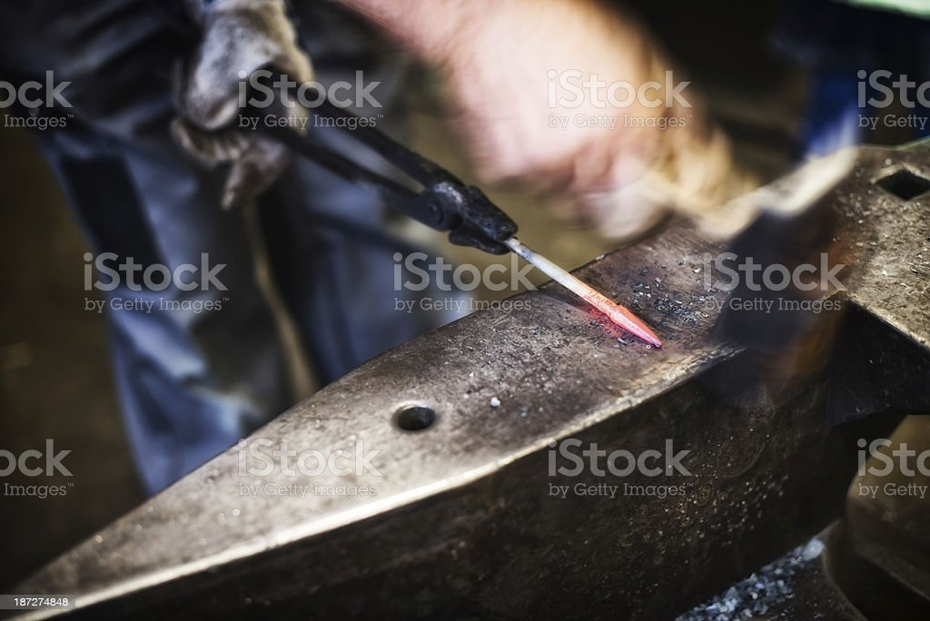 farrier man working with hammer on anvil stock photo