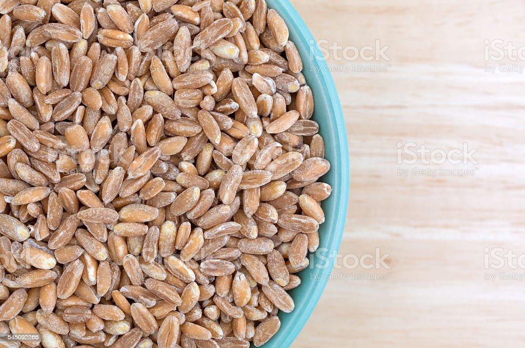 Farro organic wheat in a bowl on table top stock photo