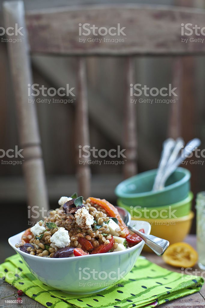 Farro salad with vegetables and cheese stock photo