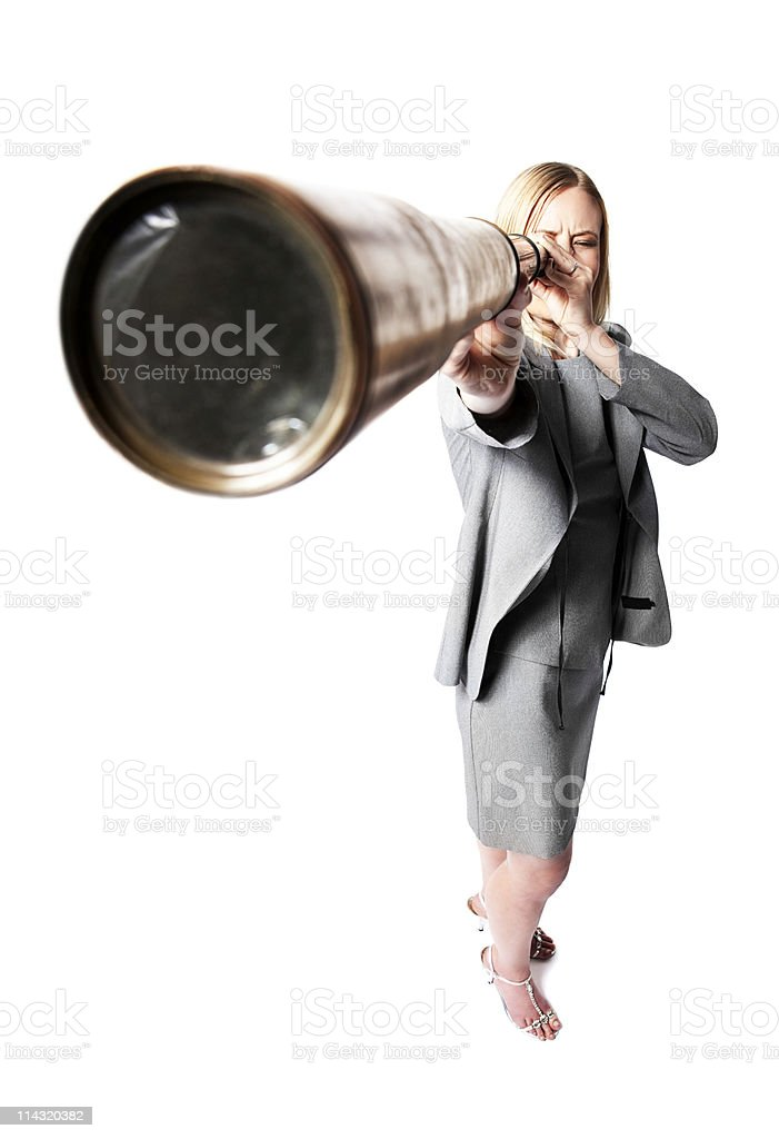 Far-sighted businesswoman looks through telescope at future royalty-free stock photo