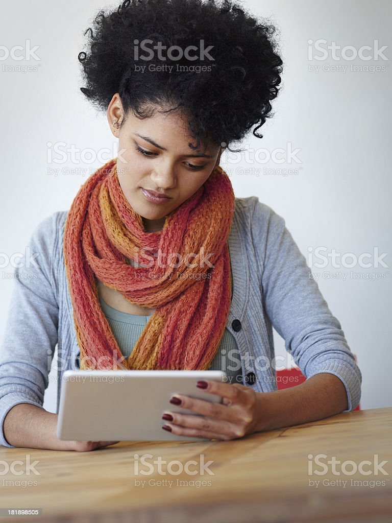Fascinated by her new tablet royalty-free stock photo