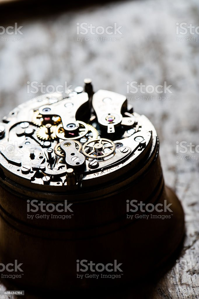 fascinating antique watch mechanism on repair table stock photo